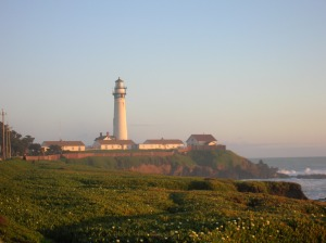 Setting Sun Illuminates a LIghthouse on the California Central Coast
