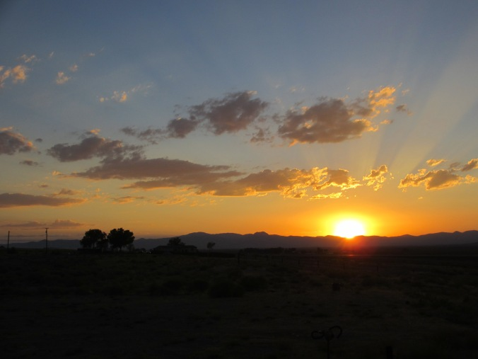 Setting Sun's Rays Illuminate the Nevada Desert Sky