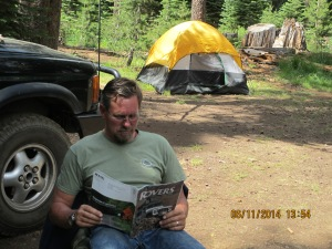 Relaxing in camp with an issue of Rovers Magazine